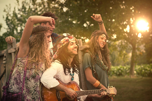 Hippies Dancing and Playing Guitar. Age effects added.