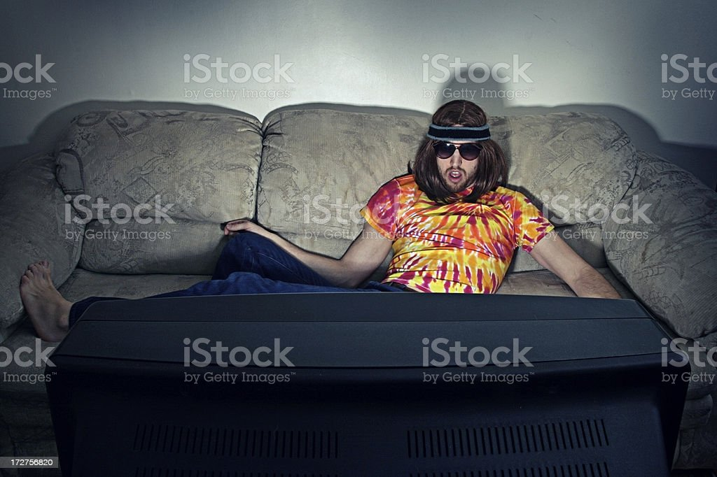 Hippy Couch Potato Watching Television stock photo