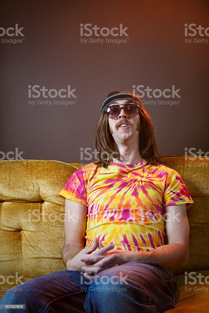 Hippy Man Sitting on Vintage Couch stock photo