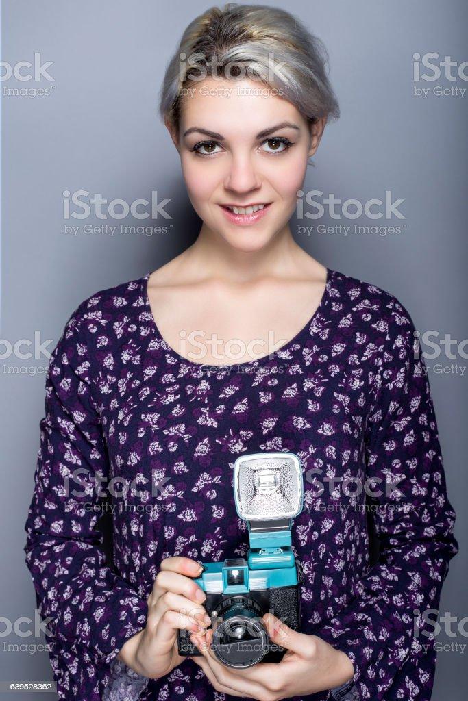 hipster art student with retro plastic film camera stock photo