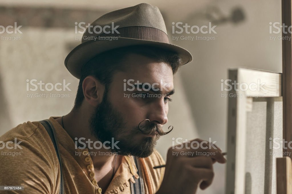 hipster artist painting in an atelier stock photo more pictures of