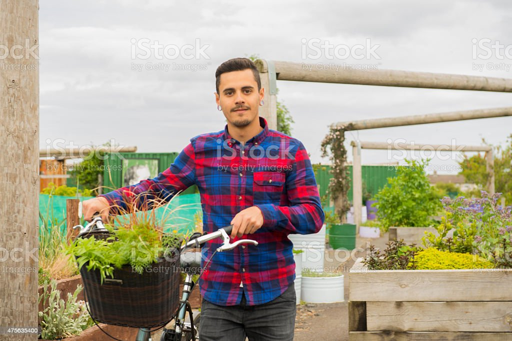 hipster at his allotment royalty-free stock photo