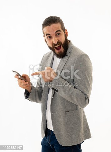 istock Hipster attractive man looking happily shocked at social media app video or blog. Surprised stylish man having lots of followers and likes online on social media network In internet and technology. 1155382147