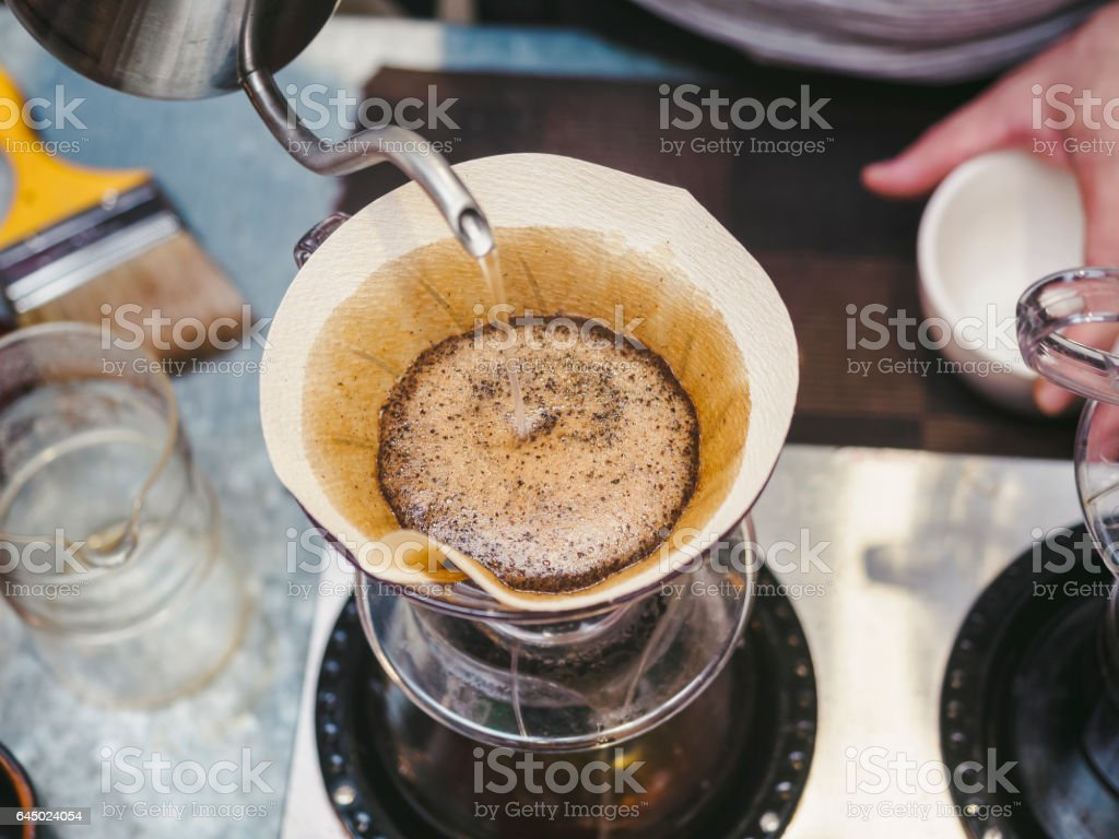 Hipster Barista making hand drip Coffee stock photo