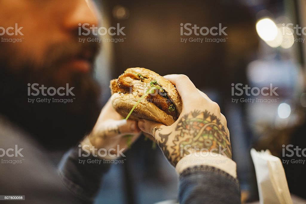 Hipster businessman during lunchtime stock photo