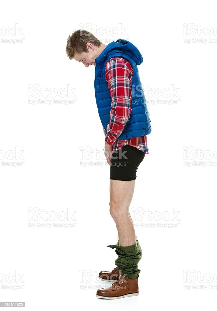 Hipster caught with his pants down stock photo