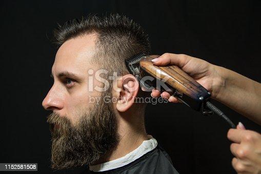 622527180istockphoto Hipster client visiting barber shop 1152581508
