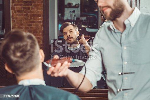 622527180istockphoto Hipster client visiting barber shop 622525808