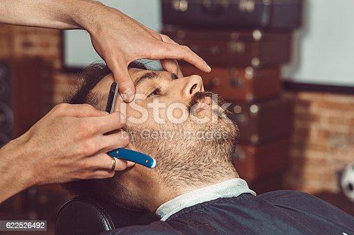 622527180istockphoto Hipster client visiting barber shop 622526492