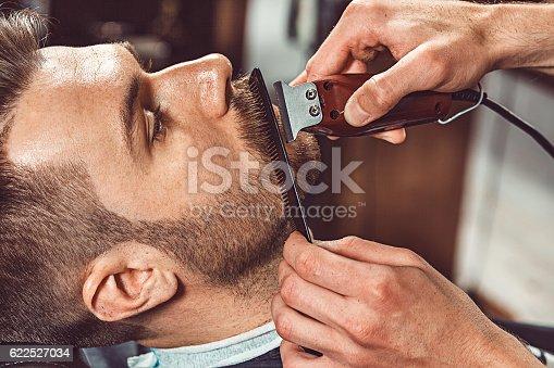 622527180istockphoto Hipster client visiting barber shop 622527034