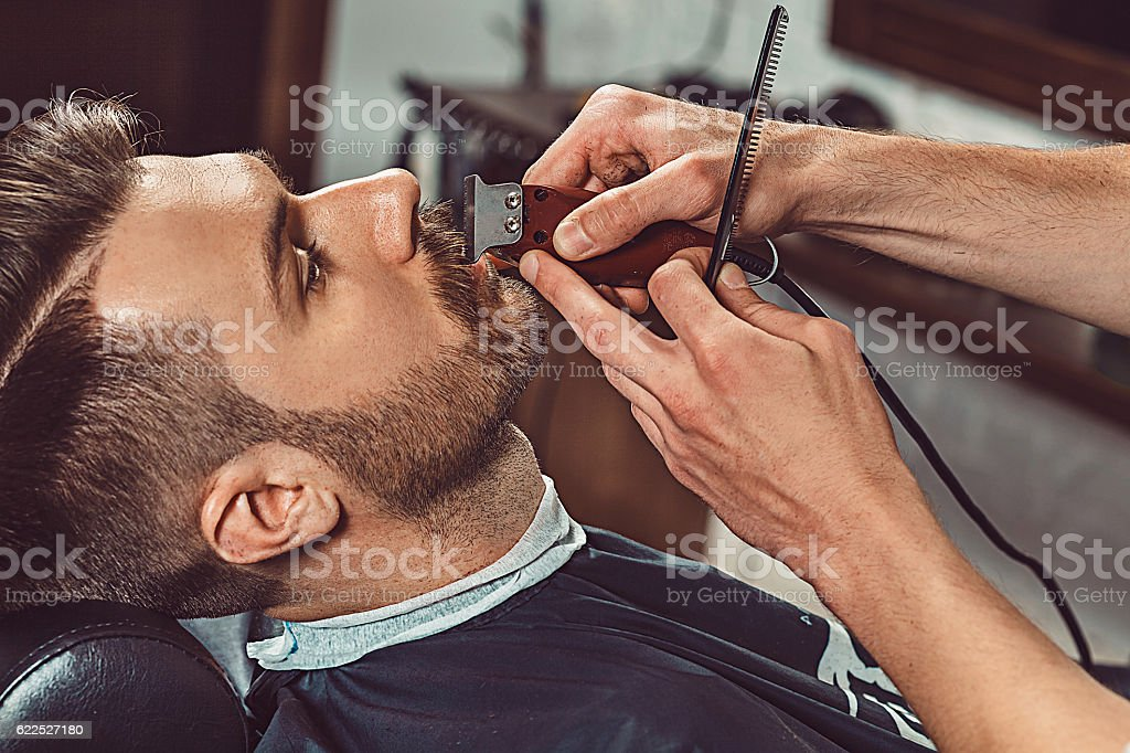 Hipster client visiting barber shop stock photo