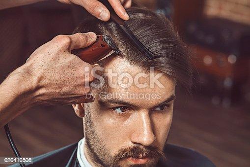 622527180istockphoto Hipster client visiting barber shop 626416508