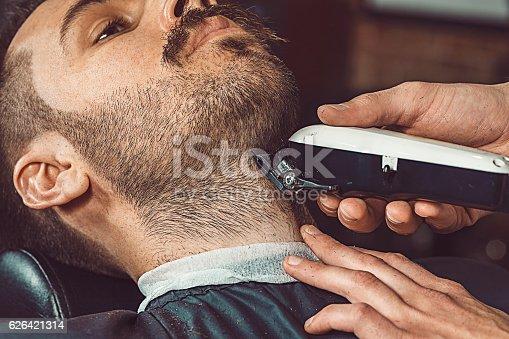 622527180istockphoto Hipster client visiting barber shop 626421314