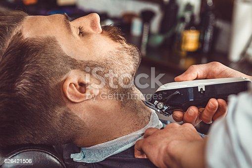 622527180istockphoto Hipster client visiting barber shop 626421506