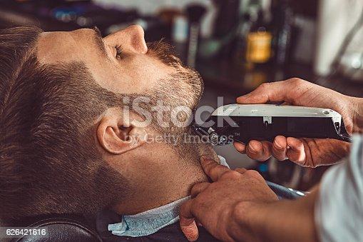 622527180istockphoto Hipster client visiting barber shop 626421616