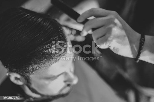 622527180istockphoto Hipster client visiting barber shop 950397750