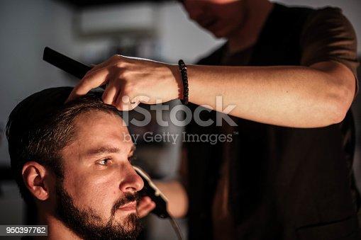 622527180istockphoto Hipster client visiting barber shop 950397762