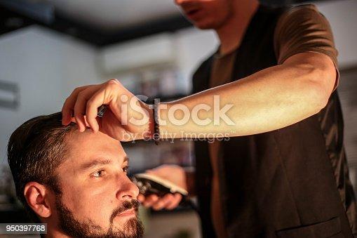 622527180istockphoto Hipster client visiting barber shop 950397768