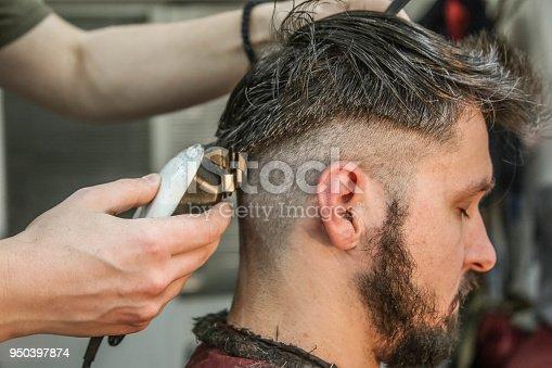 622527180istockphoto Hipster client visiting barber shop 950397874