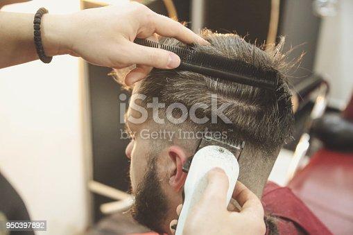 622527180istockphoto Hipster client visiting barber shop 950397892