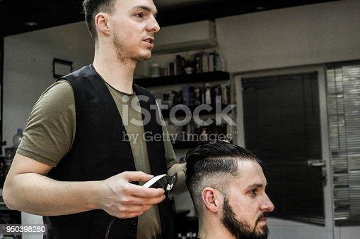 622527180istockphoto Hipster client visiting barber shop 950398280