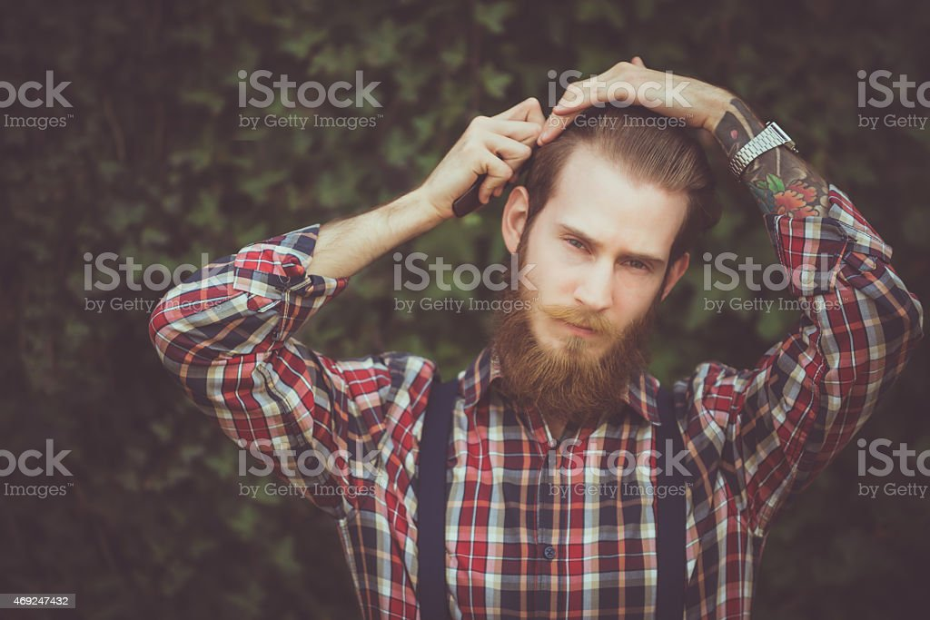 Hipster Combing Hair stock photo