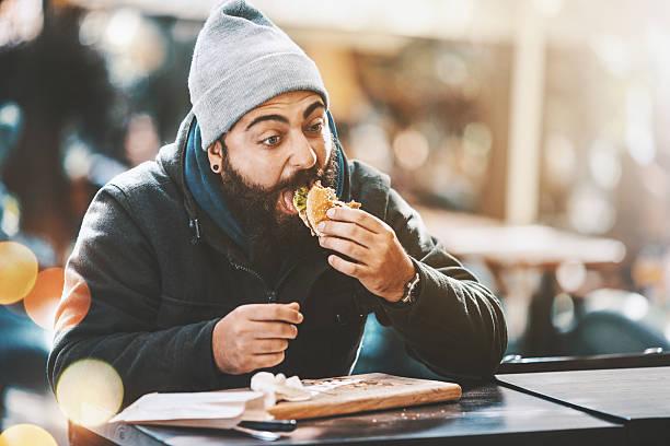 hipster do eat as well. - schmaler tisch stock-fotos und bilder