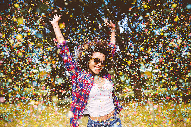 Hipster enjoying confetti stock photo