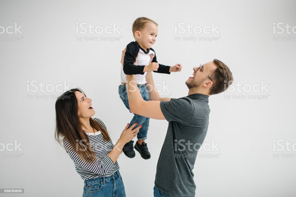Hipster father, mother holding baby boy over white isolated background – Foto