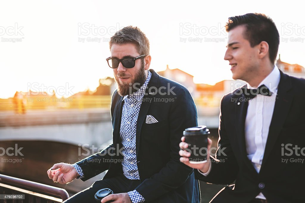 Hipster friends drinking coffee on a break stock photo