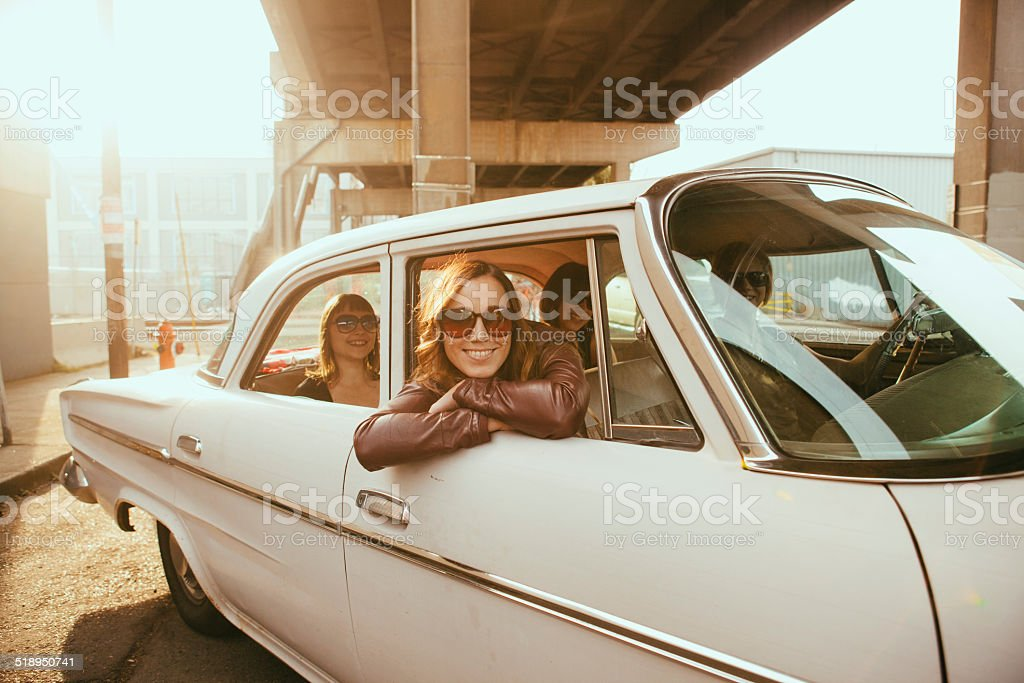 Hipster Friends In Vintage Car stock photo