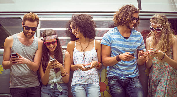 Hipster friends using their phones stock photo