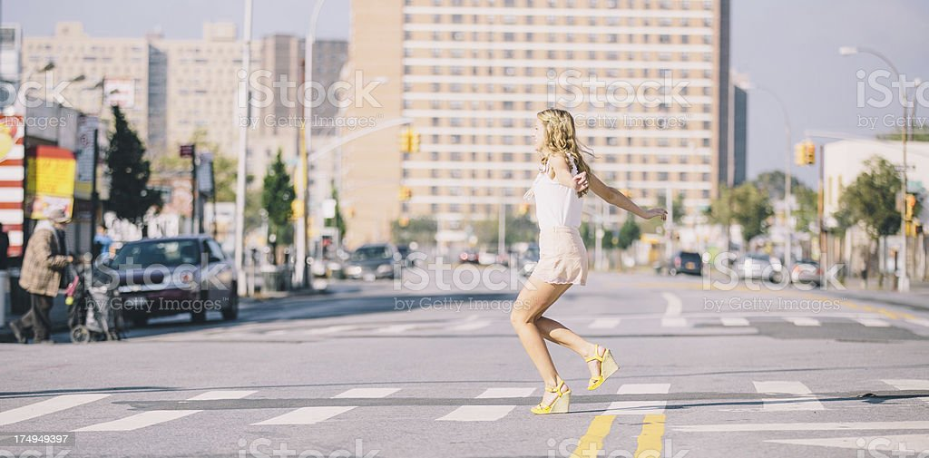 Hipster girl dancing in the street wearing wedges stock photo