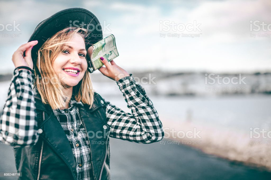 Hipster girl holding flask on the winter stock photo