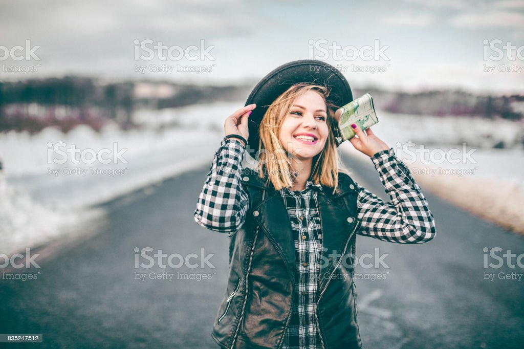 Hipster girl holding flask stock photo