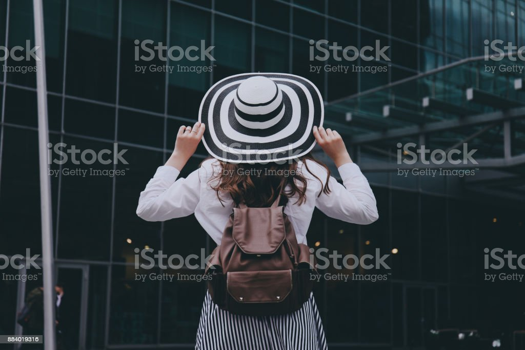 Hipster girl in a hat. stock photo