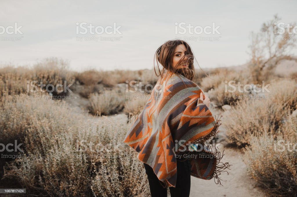 Hipster girl in gypsy look, young traveler in the USA desert stock photo