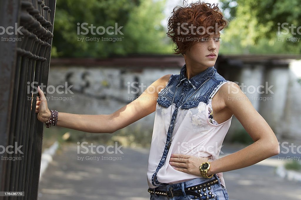Hipster girl in leather accessories with spikes stock photo