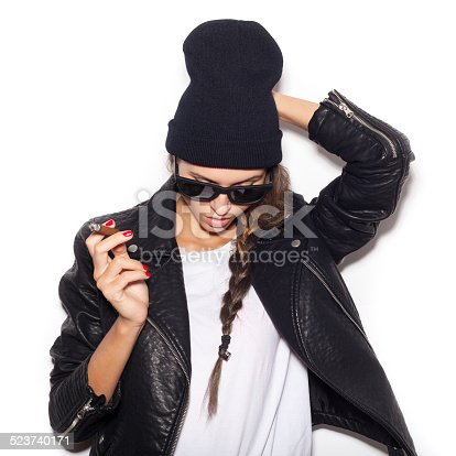 istock Hipster girl in sunglasses and black beanie  smoke cigar 523740171