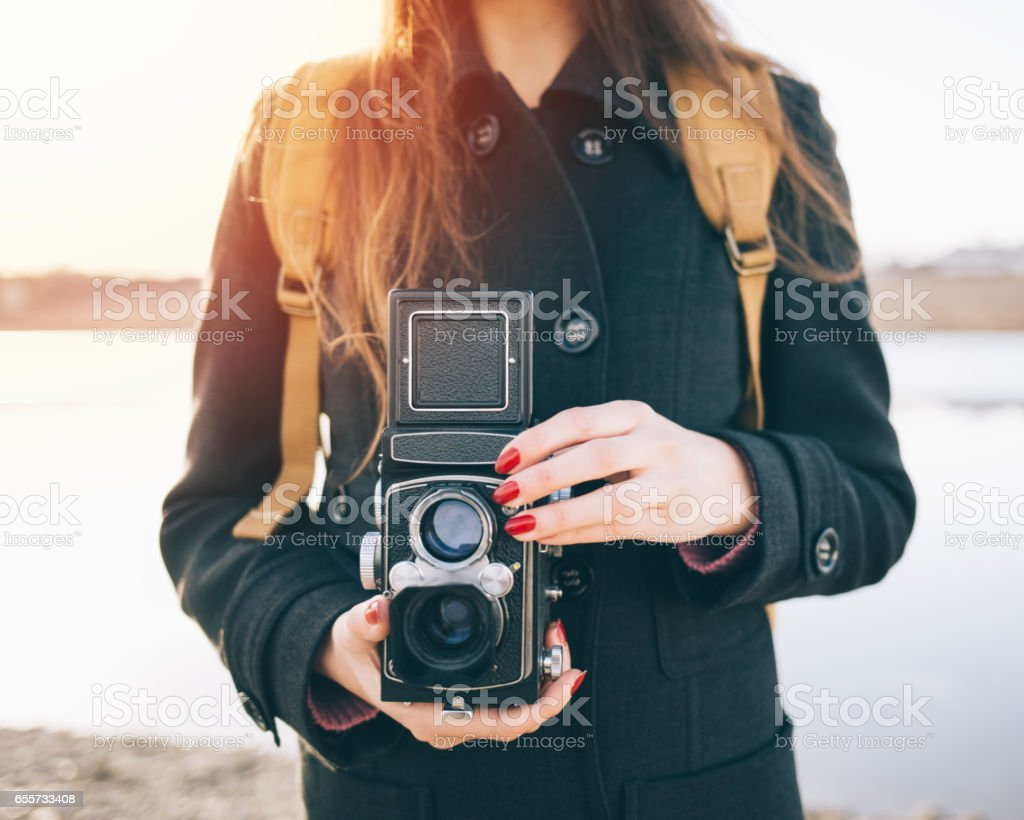 Hipster girl photographer stock photo