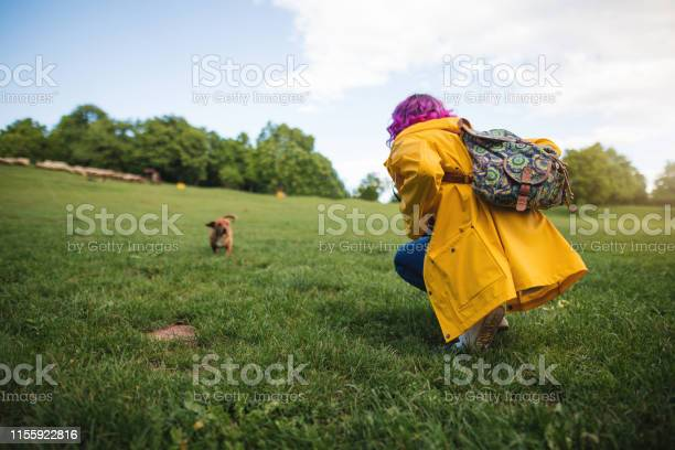Hipster girl playing with her dog at a park picture id1155922816?b=1&k=6&m=1155922816&s=612x612&h=9dmnfubjmqzsyslxksj3tb4ocqevpd cg7 t h 9uza=
