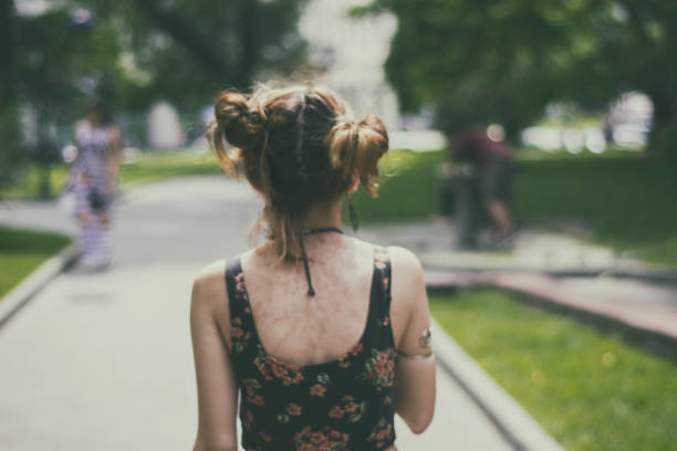 hipster girl walking in a park - punk music stock photos and pictures