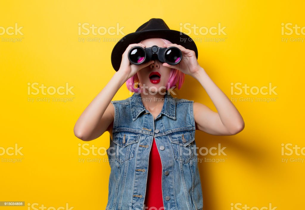hipster girl with pink hair style with binoculars stock photo