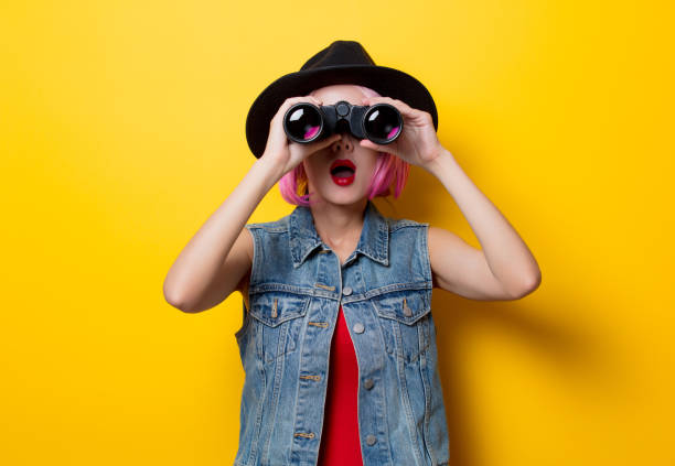 hipster girl with pink hair style with binoculars - searching stock pictures, royalty-free photos & images
