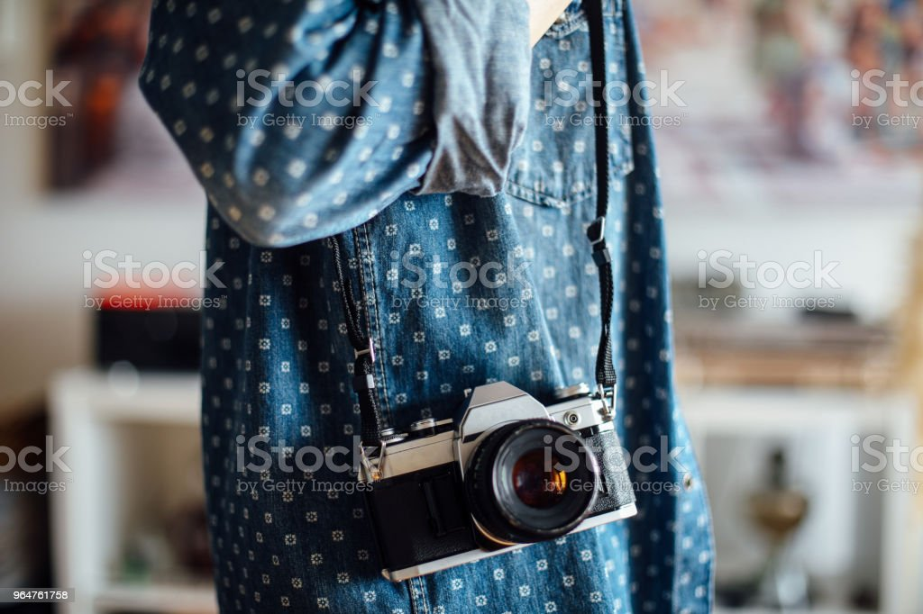 Hipster girl with retro camera taking photos royalty-free stock photo