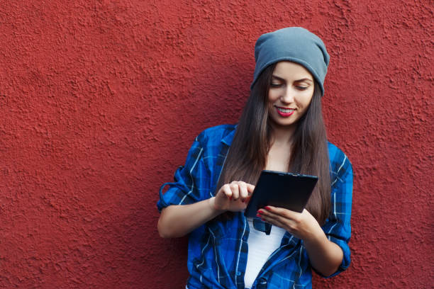 hipster girl with tablet computer - millennials stock photos and pictures