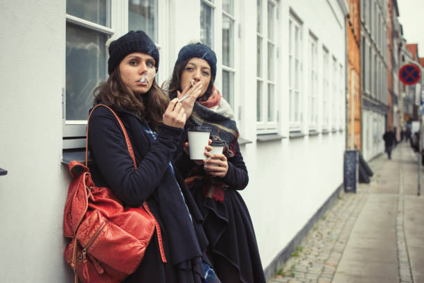 Hipster girls smoking a sigarette stock photo