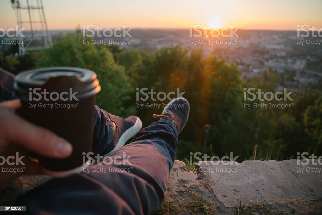 Hipster guy drinking coffee stock photo