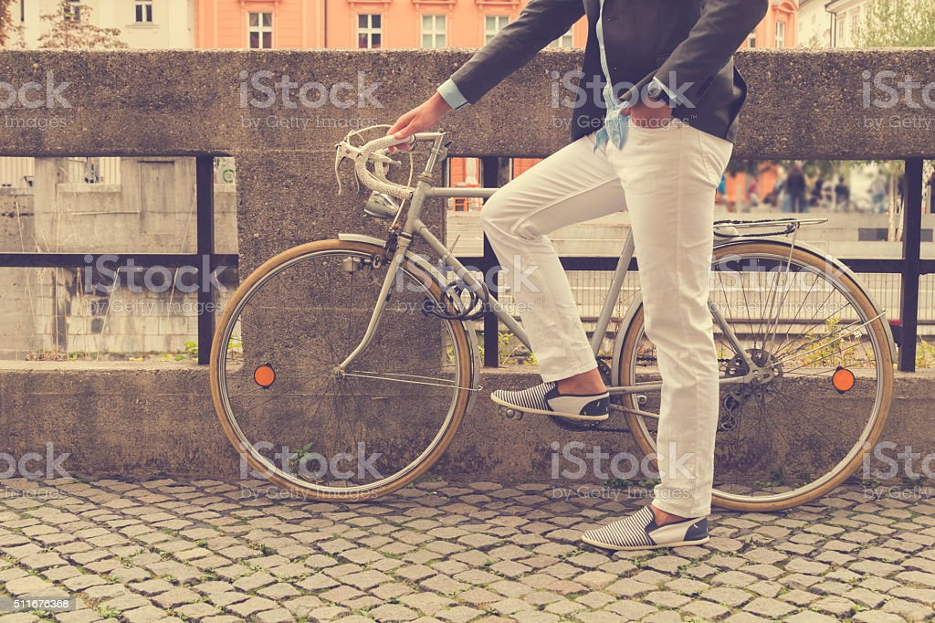 Hipster guy with bicycle outdoors. stock photo