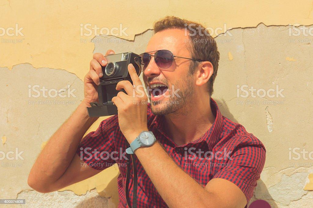 Hipster Facet z stary aparat fotograficzny. zbiór zdjęć royalty-free